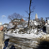 Gloucester: Mayor John Bell came for a first-hand look at the scene of the Middle Street fire Monday. The remains of the Lorraine Apartments continued to be hosed down all day Monday. <br /> Photo by Mike Dean/Gloucester Daily Times Monday, December 17, 2007