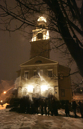 Gloucester:Temple Ahavat Achim held a memorial service in honor of the fire that destroyed the Temple and the Lorraine Apartment building last Saturday. The service started in front of the scene of the fire and proceeded to the Unitarian Universalist Church.  <br /> Photo by Deborah Hammond/Gloucester Daily Times Thursday, December 20, 2007