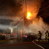 MIKE SPRINGER/Gloucester Daily Times. <br /> Firefighters battle a blaze Friday at a house on Hunters Court in Rockport.