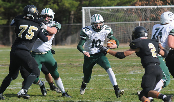 Wakefield: Manchester Essex player Craig Carter scrammbles for yardage against Northeast  during their North Sectional Semi-final in Wakefield Saturday. Jim Vaiknoras/staff photo