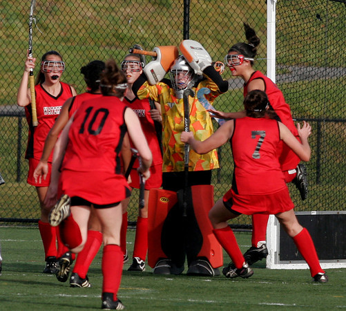 North Andover: Manchester Essex goalie Vicky Grimes holds her head as Watertown celebrates their game-tying goal in the second half of the Division II North Field Hockey Championship at North Andover High School yesterday afternoon. Watertown went on to win the game 2-1. Photo by Kate Glass/Gloucester Daily Times Sunday, November 15, 2009