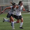 North Andover: Manchester Essex's Lizzy Ball hugs teammate Amelia Burke following her goal against Watertown in the Division II North Field Hockey Championship at North Andover High School yesterday afternoon. Photo by Kate Glass/Gloucester Daily Times Sunday, November 15, 2009