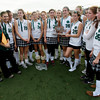 North Andover: The Manchester Essex field hockey team holds the runner-up trophy following their 2-1 loss to Watertown in the Division II North Field Hockey Championship at North Andover High School yesterday afternoon. Photo by Kate Glass/Gloucester Daily Times Sunday, November 15, 2009