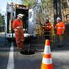 Manchester: National Grid employees, Glenn Donovan, Ryan O'Hearn, and Earl Steinman, wait for water to drain from a manhole on Summer Street so they can begin repairing electric cables. Faulty cables were the cause of the power outages over the weekend. Photo by Kate Glass/Gloucester Daily Times Monday, November 16, 2009