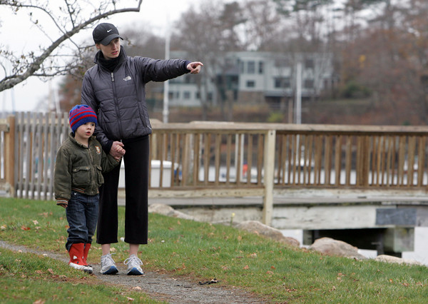 Manchester: Katrine Delisle points to some boats in the harbor to William McGahan, 4, of Manchester, while out for a walk Friday afternoon.  Katrina, who babysits William, says on of his favorite games to play is I Spy. Mary Muckenhoupt/Gloucester Daily Times