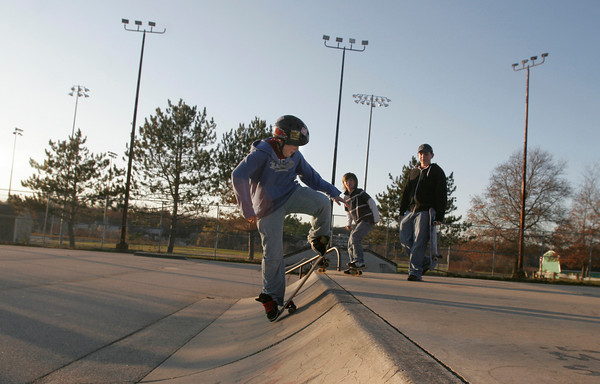 Gloucester: Adam Cooney practices his tricks at the skate park near O'Maley Middle School as Aaron Smith and Jeff Bondreau look on yesterday afternoon. Photo by Kate Glass/Gloucester Daily Times Tuesday, November 17, 2009