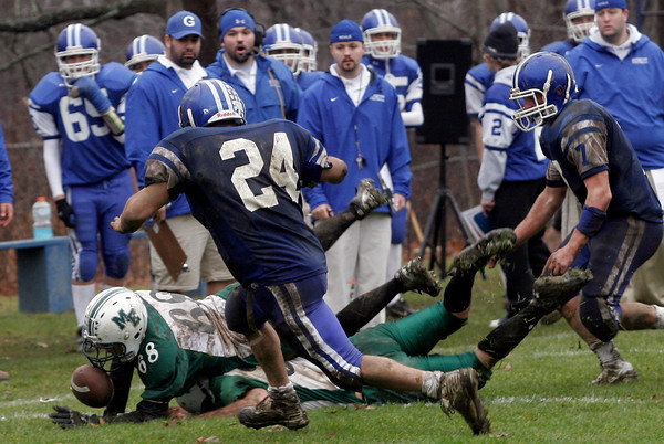 Georgetown: Manchester Essex's Justin Burke recovers the fumble after teammate Ben Kekeisen stripped the ball from the hands of Georgetown's Tyran Harrigan during their Thanksgiving game at Georgetown. The Hornets won 22-14. Photo by Kate Glass/Gloucester Daily Times Thursday, November 26, 2009