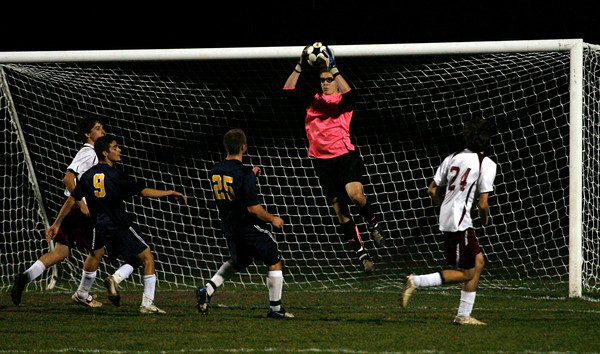 Rockport: Rockport keeper Keady Segel leaps for the ball in the Division 3 North quarterfinals against Lynnfield at Rockport High School. Photo by Kate Glass/Gloucester Daily Times Tuesday, November 10, 2009