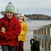 Gloucester: Breanna Jackson, 8, and her twin sister Isabelle, right, walk into the blustery wind while leaving Good Harbor beach with family friend Terry Greel Saturday afternoon.  They all decided it was too windy to stay at th beach so they left for Ravenswood Park to walk their dogs. Mary Muckenhoupt/Gloucester Daily Times
