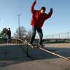 Gloucester: Jordan Brooks rides a rail at the skate park near O'Maley Middle School as Adam Cooney, left, Tom Ercolani, center, and Andrew Grammas look on yesterday afternoon. Photo by Kate Glass/Gloucester Daily Times Tuesday, November 17, 2009
