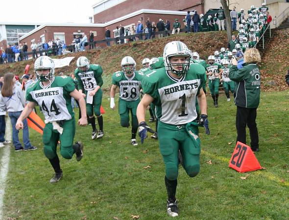 Georgetown: Manchester Essex's Jack Bishop, left, and Ben Kekeisen, right, lead the Hornets to the field for their Thanksgiving game against Georgetown. The Hornets won 22-14. Photo by Kate Glass/Gloucester Daily Times Thursday, November 26, 2009