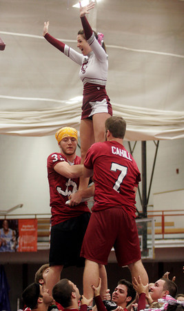 Gloucester: Conor Ressel and Brett Cahill are hoisted by their football teammates as they lift cheerleading captain Kayla Erwin during a pep rally in the Benjamin A. Smith Field House yesterday afternoon. Photo by Kate Glass/Gloucester Daily Times Wednesday, November 25, 2009