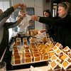 Rockport: Sue Andersen, left, adds frosting to Nicky Kern's pastry bag as Karen Andrew, Kathy Olson Taylor, and Kristen Christopher look on while assembling 300 graham cracker gingerbread houses for the Rockport PTO Holiday Fair. The fair runs from 9:30-2 this Saturday at Rockport High School. Photo by Kate Glass/Gloucester Daily Times Tuesday, November 17, 2009