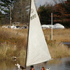 Essex: Harold Burnham and Laurie Fullerton head toward Burnham's boat yard with dog Daisy Nell who was eager to get to land after a boat ride on the Essex River Friday afternoon.  Burnham and Fullerton both agreed it was a chilly day for a boat ride and quickly went inside to warm up with some hot chocolate. Mary Muckenhoupt/Gloucester Daily Times