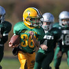 Gloucester: Riverdale Rocket's C-Team's Christian Powers is chased by three Manchester Hornet's as he heads up feild in the Pee Wee Football games that were played at Newell Stadium Sunday afternoon.. Desi Smith Photo/Gloucester Daily Times. November 1,2009.