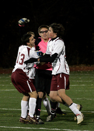 Reading: Rockport keeper Keady Segel is mobbed by his teammates following their 1-0 win over Austin Prep in the Division III North Semifinals at Reading High School last night. Photo by Kate Glass/Gloucester Daily Times Thursday, November 12, 2009