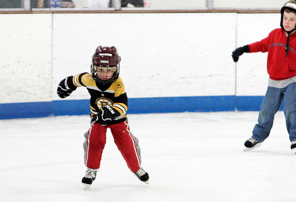 Gloucester: Jack Delaney, 4, of Gloucester skates with all his might as he makes his loop around the rink during the Harvest Hoedown Skating Party sponsored by the Cape Ann Skating Club Saturday afternoon. Also pictured, Luke Simpson, right. Mary Muckenhoupt/Gloucester Daily Times