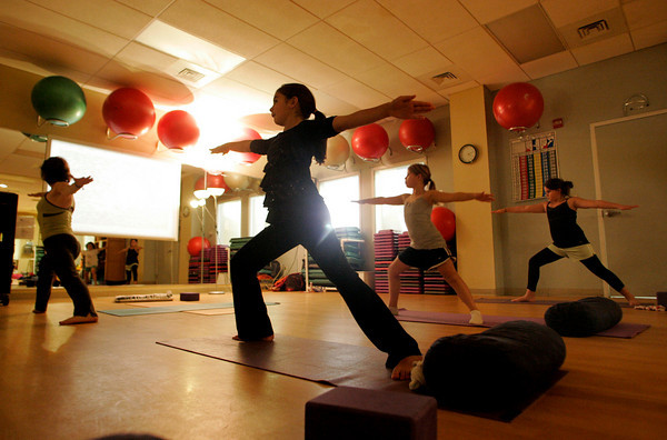 Manchester: Mckenzie Lavasco, center, holds the warrior 2 possition along with Rachel Alexander and Mackenzie Plante, right, as the Gloucester Girl Scout Troop 548 takes a yoga class with instructor Jenna Taromina at the Manchester Athletic Club friday afternoon. Mary Muckenhoupt/Gloucester Daily Times
