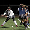 Andover: Manchester Essex's Katie Gavin winds up to blast the ball past Belmont in the Division I North Semifinals at Andover High School last night. Photo by Kate Glass/Gloucester Daily Times Wednesday, November 11, 2009