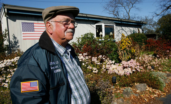 Essex: John Amirault, who has lived on Conomo Point year-round for 21 years, is afraid he will lose his home if the town does not renew the lease for the land, which expires in 2011. Photo by Kate Glass/Gloucester Daily Times Wednesday, November 4, 2009
