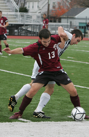 Lynn: Rockport's Scott Noble gets tangled with Weston's Adam Guerin during the Division 3 North final at Manning Field in Lynn Sunday afternoon. Weston defeated Rockport 3-0. Mary Muckenhoupt/Gloucester Daily Times