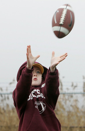 Gloucester: Nathaniel Frontiero, 8, catches a football tossed to him by his friend Matt Gately during halftime of the Gloucester Thanksgiving Day game Thursday morning. Nathaniel said he wants to play football for the Fisherman when he's older, Mary muckenhoupt/Gloucester Daily times