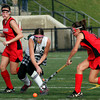 North Andover: Manchester Essex's Katie Gavin dodges between Watertown's Kaitlyn Carlson, left, and Alyssa Carlson, right, in the Division II North Field Hockey Championship at North Andover High School yesterday afternoon. Photo by Kate Glass/Gloucester Daily Times Sunday, November 15, 2009
