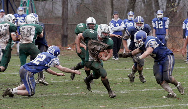 Georgetown: Manchester Essex's Jack Bishop runs between Georgetown's Andrew Bugler and Andrew Sinkewicz during their Thanksgiving game at Georgetown. The Hornets won 22-14. Photo by Kate Glass/Gloucester Daily Times Thursday, November 26, 2009