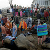 Gloucester: Swimmers dry off as spectators stay dry after the 21st annual Thanksgiving Day Swim which took place off Thurston Point Road Thursday morning around 8:30 a.m.. Mary Muckenhoupt/Gloucester Daily Times