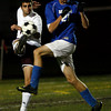 Gloucester: Gloucester's Anthony LaRocca blasts the ball past Danvers' Nicholas Amico during their last game of the season at Newell Stadium last night. Photo by Kate Glass/Gloucester Daily Times Monday, November 2, 2009