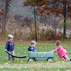 Manchester: Jarrett Croft and Sydney Bartlett, both 2, push Carson Croft, 2, around the bases at Masconomo Park Tuesday afternoon. The three were taking turns pushing each other in the wagon. Photo by Kate Glass/Gloucester Daily Times Tuesday, November 10, 2009