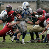Gloucester: Danvers linebacker John McInnis runs through Gloucester defenders before running 90 yards for a touchdown in the second half of the Thanksgiving Day game at Newell Stadium in Gloucester Thursday morning. Gloucester defeated Danvers 35-7. Mary Muckenhoupt/Gloucester Daily Times