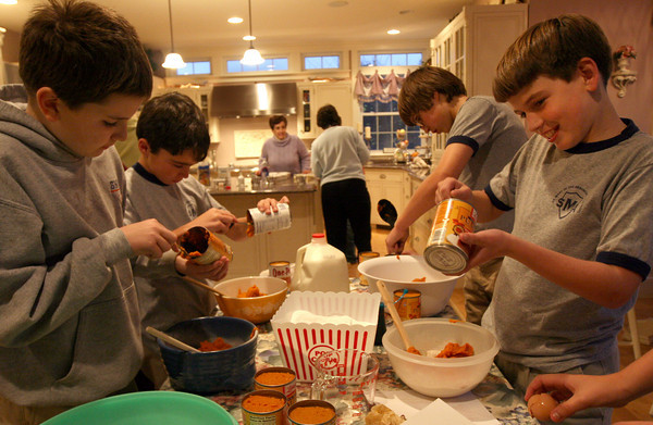 Gloucester: From left: William McGuinness of Danvers, BJ Mohan of Gloucester, Steven Suchcicki of Danvers, and Kevin Redmond of Gloucester measure out ingredients for pumpkin pie as they and their 6th grade classmates at Saint Mary of the Annunciation School in Danvers bake 40 pies for My Brother's Table in Lynn. Each student brought two cans of pumpkin and $5 to cover expenses. Photo by Kate Glass/Gloucester Daily Times Wednesday, November 24, 2009