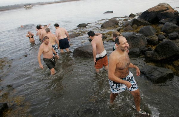 Gloucester: A steady stream of brave swimmers filed in and out of the water for the 21st annual Thanksgiving Day Swim off Thurston Point Road on Wheeler's Point Thursday morning.  A few dozen people went into the water and commented on how warm it was as compared to years past. Mary Muckenhoupt/Gloucester Daily Times