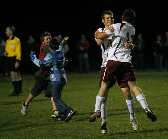Rockport: Rockport's Mike Emerson hugs teammate Scott Noble following their 1-0 victory over Lynnfield in the Division 3 North quarterfinals at Rockport High School. Photo by Kate Glass/Gloucester Daily Times Tuesday, November 10, 2009