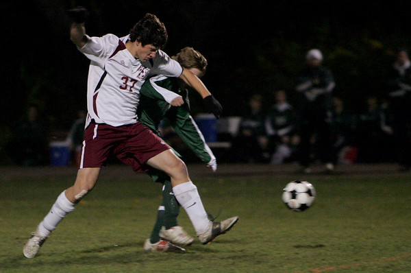 Rockport: Rockport's Kevin Corrigan runs up against a North Reading defender to maintain possession during the first half of the soccer game held at Rockport High School Tuesday night. Mary Muckenhoupt/Gloucester Daily Times