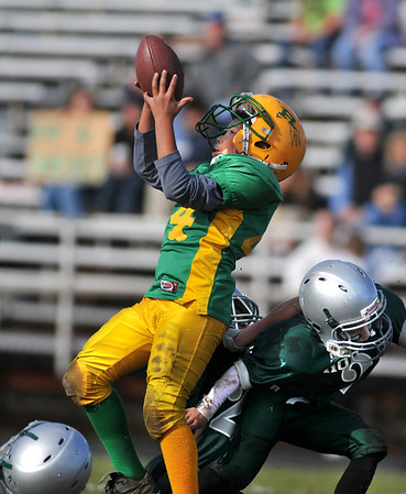 Gloucester: Riverdale Rocket's C-Team's Jon Jon Mondello pulls in a pass durring,Sunday's Pee Wee Football Game at Newell Stadium. Desi Smith Photo/Gloucester Daily Times. November 1,2009.