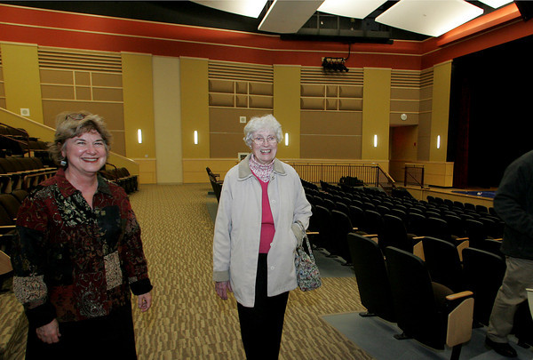 Manchester: Mary Helming gets walks through the new auditorium while receiving a tour of the new Manchester Essex Regional High School from Superintendent Maria O'Neil Thursday afternoon. Helming graduated from Story High School in Manchester in 1936. Mary Mcukenhoupt/Gloucester Daily Times