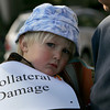 Gloucester: Sam Cook, 3, wears a sign in protest of a charter school coming to Gloucester while waiting for a hearing of the State Board of Elementary and Secondary Education over it's approlval of the Gloucester Charter School at City Hall Saturday afternoon. Many fear the new charter school wil draw too much money away from the other schools in the district. Mary Muckenhoupt/Gloucester Daily Times