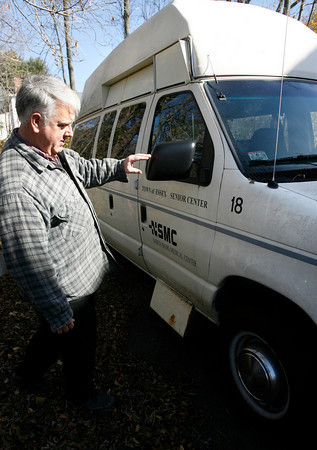 Essex: George Harvey, who drives the Essex Council on Aging van, points out rusty spots on the vehicle, which has over 100,000 miles on it and is getting expensive to repair. The COA is hoping the town will approve funding for a new van during Town Meeting on Monday. Photo by Kate Glass/Gloucester Daily Times Wednesday, November 4, 2009