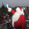 Gloucester: Santa waves to the crowd from the back of a Fire ladder truck as he arrives at  Kent Circle Sunday night. Desi Smith Photo/Gloucester Daily Times. November 29,2009.
