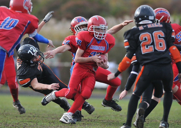 Gloucester: Charger's A-Team's Devon Murry looks for some running room against the Hampton Hill Tigers,Sunday afternoon at Newell Stadium. Desi Smith Photo/Gloucester Daily Times. November 1,2009.