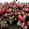 Gloucester: The Gloucester Fisherman celebrate with their trophy after winning the Thanksgiving Day football game against Danvers at Newell Stadium Thursday. Mary Muckenhoupt/Gloucester Daily Times