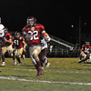 Gloucester: Gloucester's Conor Ressel goes in for a Touch Down in the 2nd Quarter against Lynn English last night at Newell Stadium. Desi Smith Photo/Gloucester Daily Times. October 30,2009.