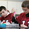 Gloucester: Zach Smith uses a micro pipettor to prepare DNA samples in Eric Leigh's freshman biology class Thursday morning. Thanks to a grant given to Gloucester High School, students a given a hands on opportunity to understand the bio tech process. Also pictured Steven Cardone, left. Mary Muckenhoupt/Gloucester Daily Times