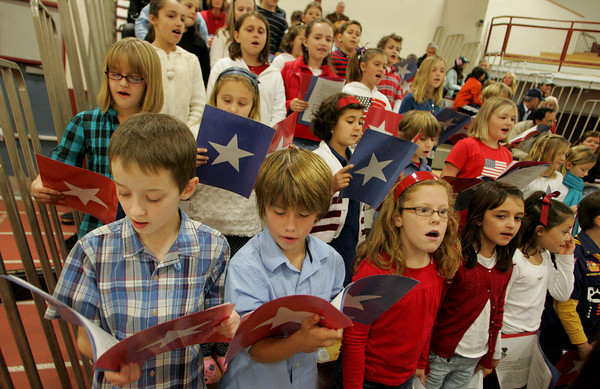 Gloucester: Members of the Plum Cove School Singers sing patriotic songs under the direction of Connie Richards during the Veterans Day Ceremony at Gloucester High School Wednesday morning. Mary Muckenhoupt/Gloucester Daily Times