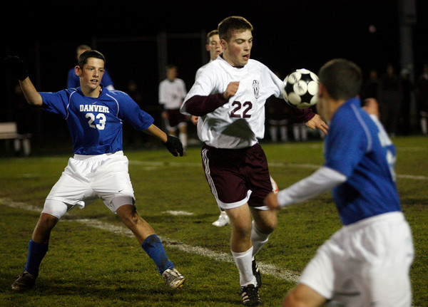 Gloucester: Gloucester's Isaac Sperry keeps an eye on the ball as they play Danvers at Newell Stadium last night. Photo by Kate Glass/Gloucester Daily Times Monday, November 2, 2009