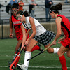 North Andover: Manchester Essex's Kyle Marsh maneuvers between Watertown's Bianca Jones, left, and Kaitlyn Carlson, right, in the Division II North Field Hockey Championship at North Andover High School yesterday afternoon. Photo by Kate Glass/Gloucester Daily Times Sunday, November 15, 2009