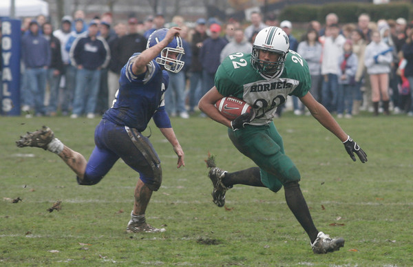 Georgetown: Manchester Essex's Seth Young runs past Georgetown's Chris Esposito after intercepting the ball during their Thanksgiving game in Georgetown yesterday. The Hornets won 22-14. Photo by Kate Glass/Gloucester Daily Times Thursday, November 26, 2009