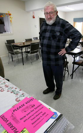 Essex: Bob Cameron, Chairman of the Essex Council on Aging, looks over the signs they will be posting urging people to approve funding for a new Senior Center van during Town Meeting on Monday. Photo by Kate Glass/Gloucester Daily Times Wednesday, November 4, 2009